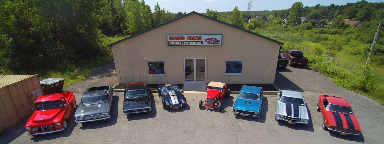 The Powerhouse shop from above with 8 sports cars lined up out front